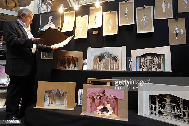 A man looks at drawings from the Folies Bergere displayed at the Palais de la Bourse as part of the Ventes de folie auction in Paris on June 8 2012...
