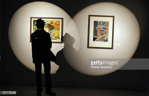 A man looks at draws made by American comics author Art Spiegelman during the 39th edition of Angouleme world comic strip festival headed by...