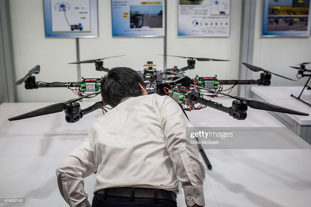 A man looks at drones on display at the International Drone Expo 2015 at Makuhari Messe on May 21, 2015 in Chiba, Japan.