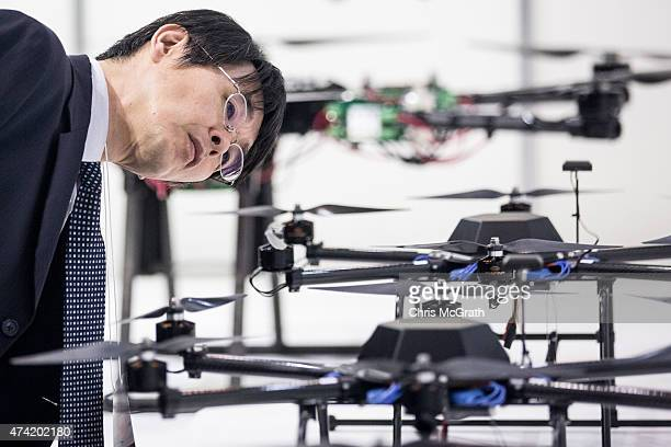 A man looks at drones on display at the International Drone Expo 2015 at Makuhari Messe on May 21 2015 in Chiba Japan