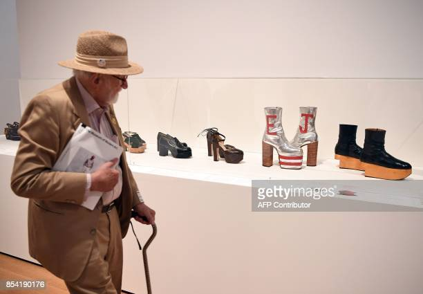 A man looks at fashion on display during a press preview for the Items Is Fashion Modern Exhibition at the Museum of Modern Art on September 26 2017...