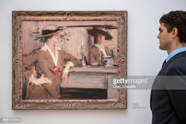 A man looks at Francis Campbell Boileau Cadell's 'Reflection' on view as part of Sotheby's British Art Week at Sotheby's on June 8 2018 in London...
