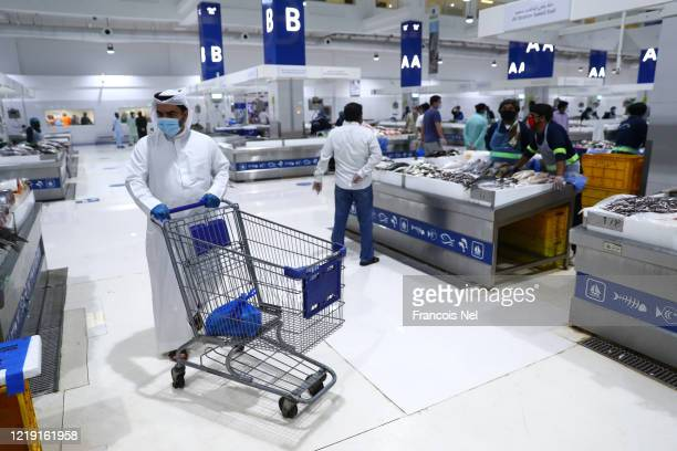 A man looks at fresh fish at the Waterfront Market on April 16 2020 in Dubai United Arab Emirates The Coronavirus pandemic has spread to many...