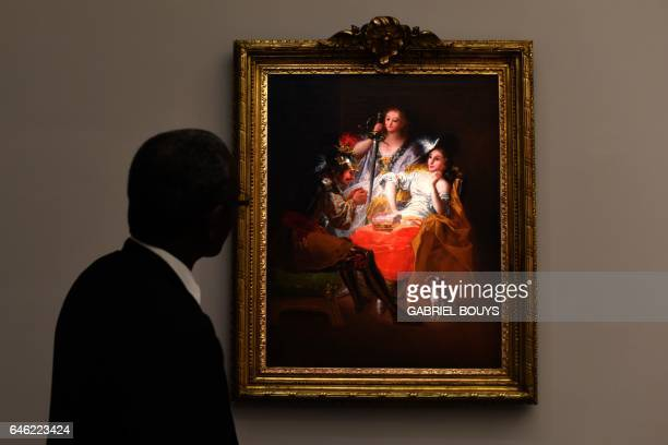 A man looks at 'Hercules and Omphale' by Francisco de Goya y Lucientes during a media preview of the exhibition 'From Zurbaran to Rothko Collection...