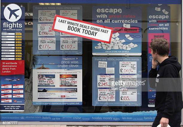 A man looks at holidays for sale in a Thomas Cook travel agent window in Keynsham on August 13 2008 in Bristol England The chain of travel agents has...