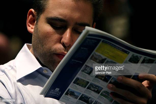 A man looks at homes to be auctioned during an auction for more than 25 foreclosed homes at the Renaissance Newark Airport Hotel on June 20 2009 in...