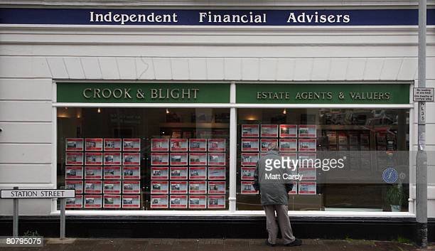 A man looks at houses advertised for sale in an estate agent's window on April 21 2008 in Newport Wales A poll by researchers Fitch has revealed 10...