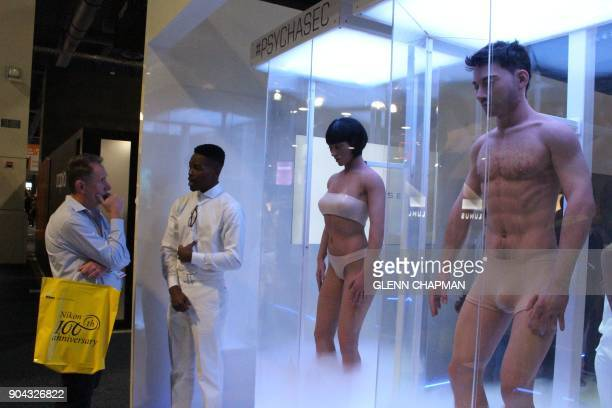A man looks at human models as part of a stunt by Netflix to promote a new show 'Altered Carbon' at the Consumer Electronics Show in Las Vegas Nevada...