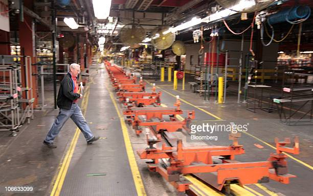 A man looks at items up for auction on the assembly line at the permanently shutdown General Motors Co Pontiac Assembly plant in Pontiac Michigan US...