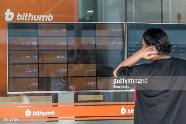 A man looks at monitors displaying the prices of cryptocurrencies at a Bithumb exchange office in Seoul South Korea on Wednesday June 20 2018 Virtual...