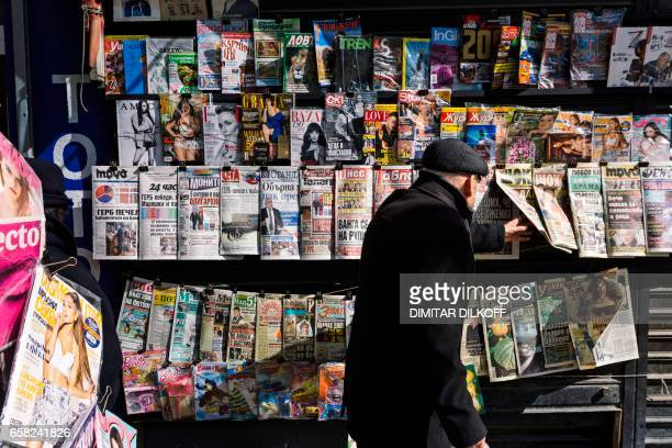 A man looks at newspapers' front pages at a newstand in downtown Sofia on March 27 2017 a day after the country's parliamentary election Bulgaria's...