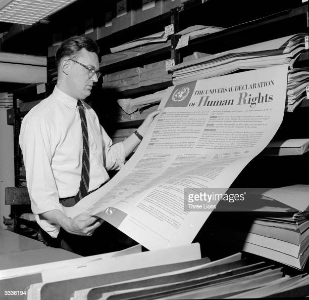 Man looks at one of the first documents published by the United Nations, The Universal Declaration of Human Rights, which was ratified in 1948.