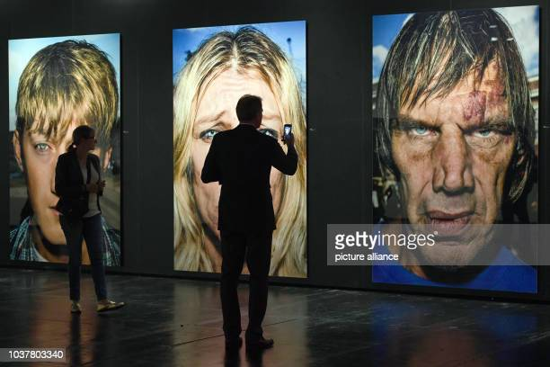 Man looks at portrait photos from Bruce Gilden can be seen in the exhibit Masters of Photography at the photokina in Cologne, Germany, 20 September...