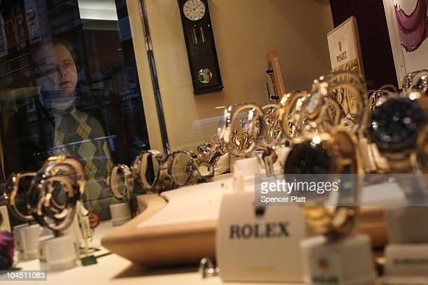 Man looks at Rolex watches on display in a window on September 28, 2010 in New York City. A new report released by the U.S. Census Data shows that...