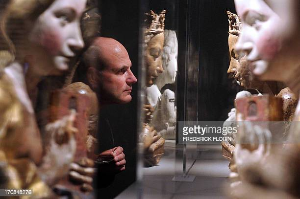 A man looks at sculptures made by late Dutch sculptor Nikolaus Gerhaert van Leyden on March 29 2012 at the NotreDame museum in Strasbourg eastern...