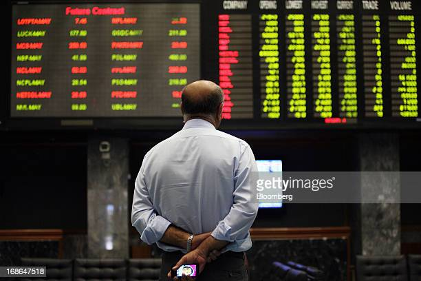 A man looks at stock boards in the trading hall at the Karachi Stock Exchange in Karachi Pakistan on Monday May 13 2013 Pakistan's stocks climbed the...