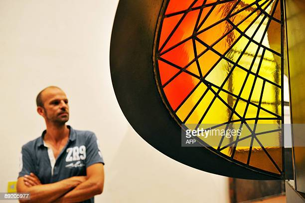 A man looks at Swiss artist Johannes Itten's 'Tower of Fire' at the 'Bauhaus A Conceptual Model' exhibition in Berlin on July 23 2009 The exhibition...