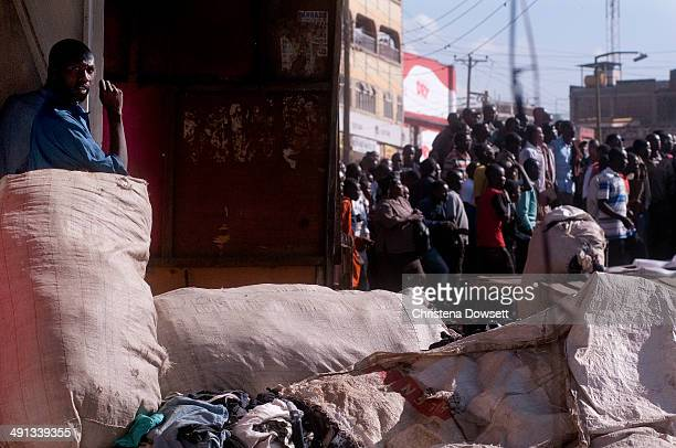 A man looks at the aftermath of two improvised explosive devices went off in Gikomba market on May 16 2014 in Nairobi Kenya Two improvised explosive...
