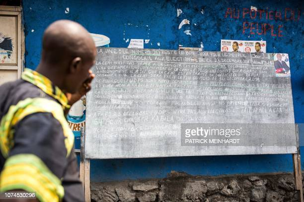 Man looks at the announcement's board outside the regional office of the Democratic Republic of Congo's Union for Democracy and Social Progress in...