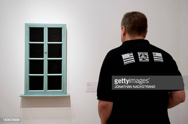 A man looks at the artwork 'Fresh Widow' by French artist Marcel Duchamp during the Picasso/Duchamp 'He was wrong' exhibition at the Moderna Museet...