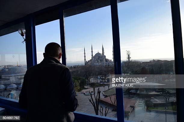 A man looks at the Blue Mosque near the site of a blast in Istanbul's tourist hub of Sultanahmet on January 12 2016 At least 10 people were killed...