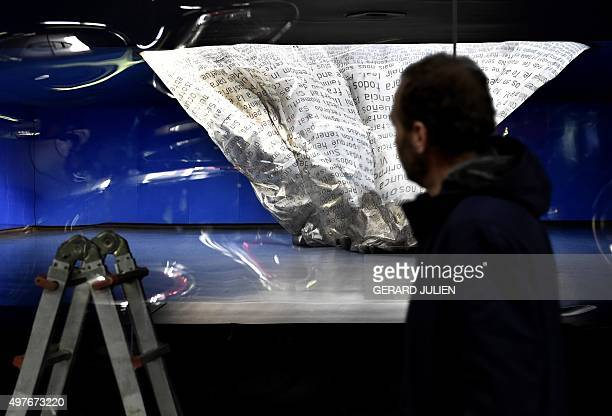 A man looks at the crumpled memorial monument to the victims of the 2004 Madrid train bombings inside the citys Atocha railway station in Madrid on...