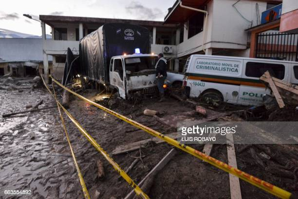 A man looks at the damage caused by mudslides following heavy rains in Mocoa Putumayo department southern Colombia on April 1 2017 Massive mudslides...