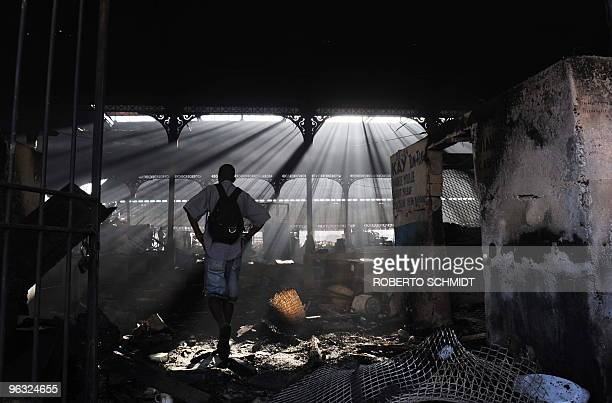A man looks at the damage to the iron market after a fire ripped through it last night in PortauPrince on January 30 2010 Quakehit Haiti will need at...