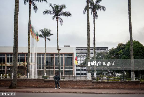 A man looks at the damaged building of Cameroon's parliament on November 17 2017 in Yaounde after a fire swept through the main building overnight...