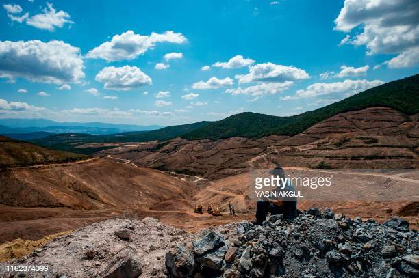 A man looks at the gold mine site project by Canadabased Alamos Gold in a deforestated area in Turkey's northwestern province of Canakkale near the...