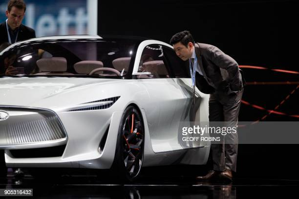 A man looks at the Infiniti Q Inspiration at the Press Preview for the 2018 North American International Auto Show in Detroit Michigan January 15...