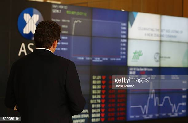 A man looks at the main board of the Australian Securities Exchange building on November 10 2016 in Sydney Australia Americans voted yesterday to...