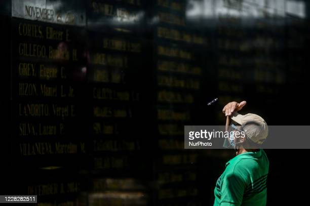 Man looks at the names of the martyrs and heroes who fought the Marcos dictatorship in commemoration of National Heroes Day in Quezon City, Metro...