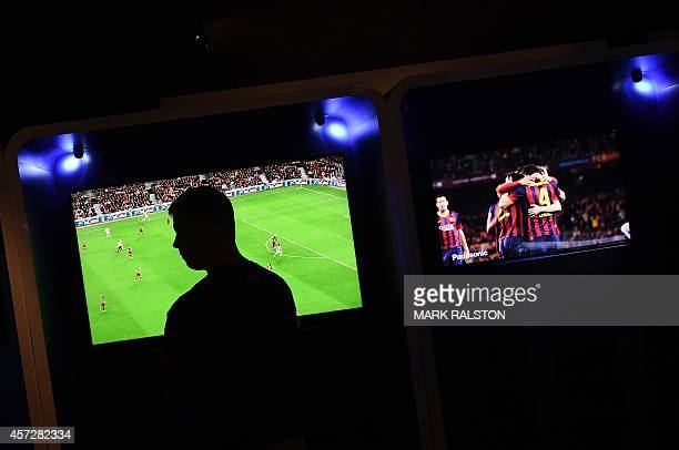 A man looks at the new Panasonic 4K Ultra HD LED TV on display at the Luxury Technology Show in Beverly Hills on October 15 2014 4K televisions...