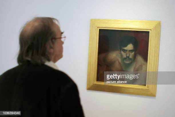 A man looks at the painting 'A Bad Conscience'  by Franz von Stuck at the museum in Wiesbaden Germany 06 May 2013 After almost four years of redesign...