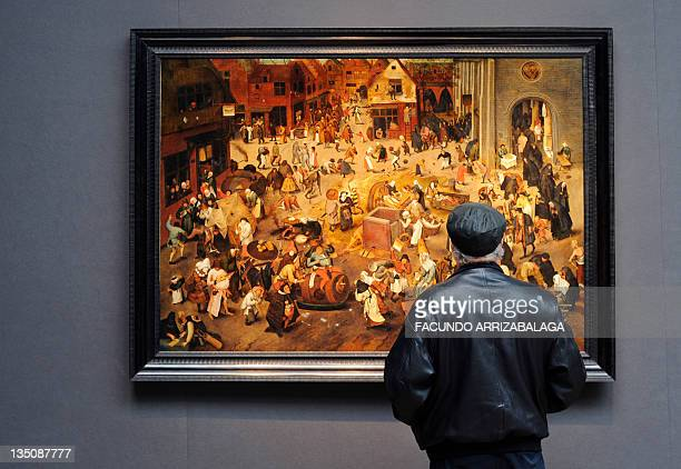 A man looks at the painting The Battle between Carnival and Lent by Dutch painter Pieter Brueghel II valued at between 35 million and 45 million...