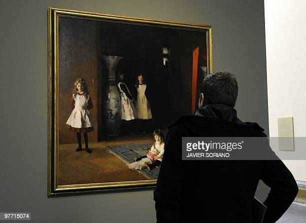 A man looks at the painting The Daughters of Edward Darley Bolt by US painter John Singer Sargent at El Prado museum in Madrid on March 15 2010 The...