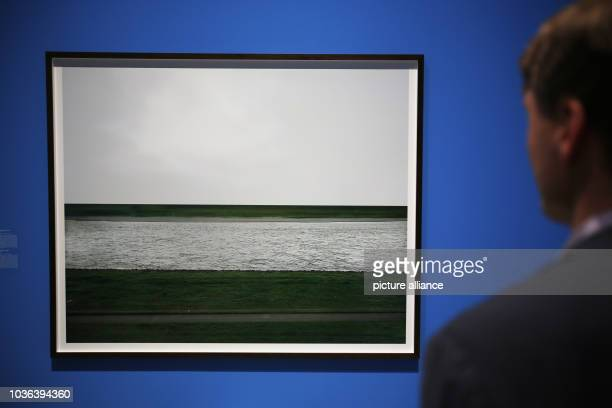 A man looks at the photograph 'The Rhine I' by Andreas Gursky in the Bundeskunsthalle in Bonn Germany 07 September 2016 The exhibition 'The Rhine The...