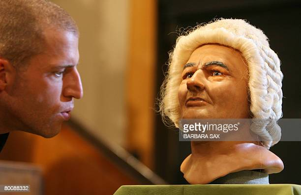 A man looks at the reconstruction of the face of late German composer Johann Sebastian Bach is pictured during its presentation on March 3 2008 at...