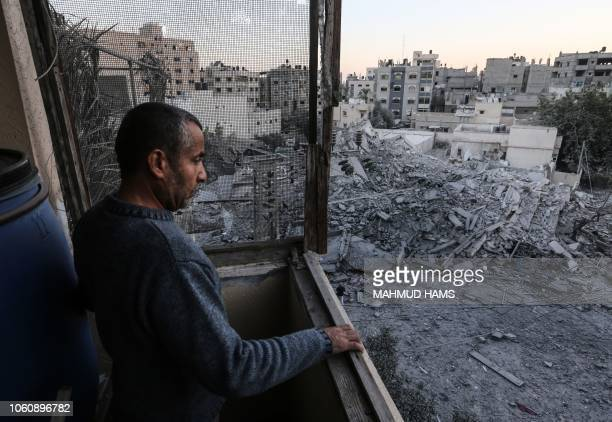 A man looks at the rubble of a building in Gaza City on November 13 after an Israeli air strike Renewed violence in Gaza threatened to thwart efforts...