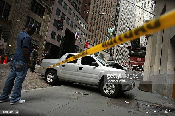 A man looks at the scene of a deadly truck crash in the financial district on August 23 2012 in New York United States The afternoon accident which...