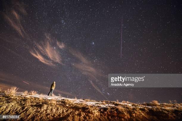 A man looks at the sky during the Geminid meteor shower in Van eastern Turkey on December 13 2017