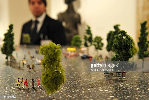 A man looks at the Tavolo Riccio display by Arturo Montanelli during the Farnesina Palace and its collections exhibition at the Ara Pacis museum in...