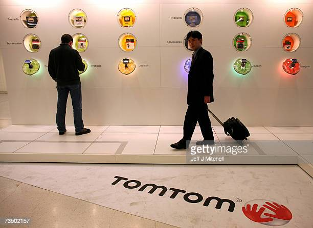 A man looks at the Tom Tom satalite navigation systems displayed at the 77th International Motor Show February 62007 in Geneva Switzerland The first...