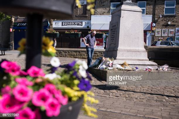 A man looks at tributes left for murdered Member of Parliament Jo Cox to mark the first anniversary of her death near to the location where she was...