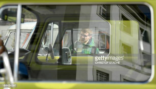 A man looks at vintage Volkswagen buses during an autumn rally of socalled 'Bulli' enthousiasts in front of the abbey Schaeftlarn near Munich...