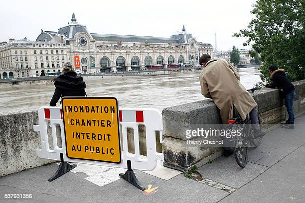 A man looks at waters of the river Seine became flooded following heavy rainfalls on June 3 2016 in Paris France Northern France is experiencing wet...