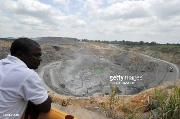A man looks at work at the diamond mining company Koidu Holdings plant in Koidu the capital of the diamondrich Kono district in eastern Sierra Leone...