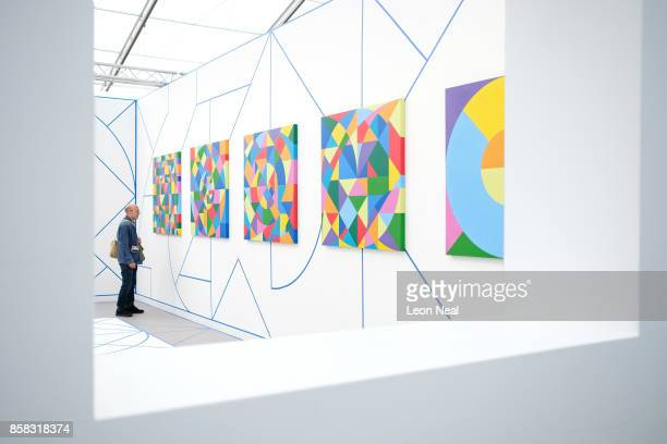 A man looks at works by Eduardo Terrazas at the Frieze Art Fair on October 6 2017 in London England The annual event sees galleries showcase work by...
