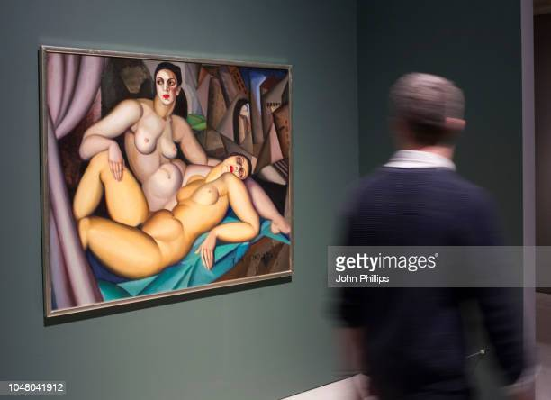 A man looks at works tilted 'Les Deux Amies ' by Tamara de Lempicka during the Modern Couples Art Intimacy and the Avantgarde press view at the...